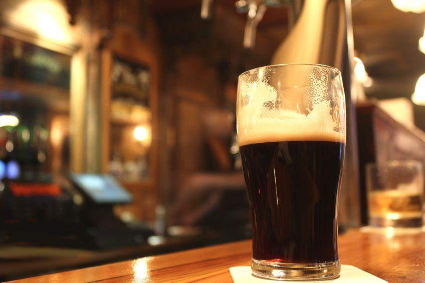13282681 - dark beer served in a pub